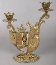 A Brass Religious Candlestick with Hinged Opening revealing the Star of David at the Top of Each