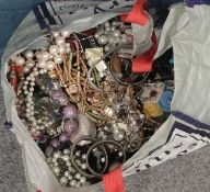 A large bag of costume jewellery. Including beads, bangles, brooches, necklaces, etc.