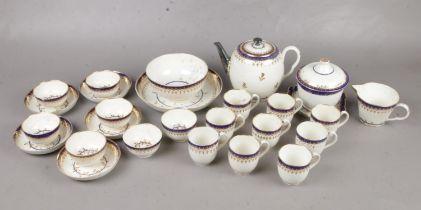 A twenty seven piece early Worcester tea ware set. To include, teapot, tea bowls, cream jug and