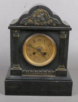 A Black Slate Marble Clock with Gold Cartouche Decoration to the Top. Crack in the Glass on the