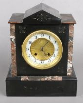 A Black Slate and Marble Mantel Clock with 'The Britannia Movement'. Height 27cm. Condition Fair,