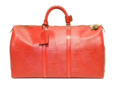A Louis Vuitton red Epi Keepall 50 luggage bag,