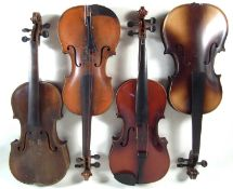 Four violins in cases