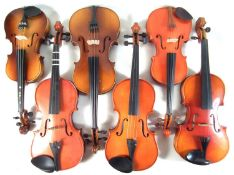 Six Chinese violins in cases
