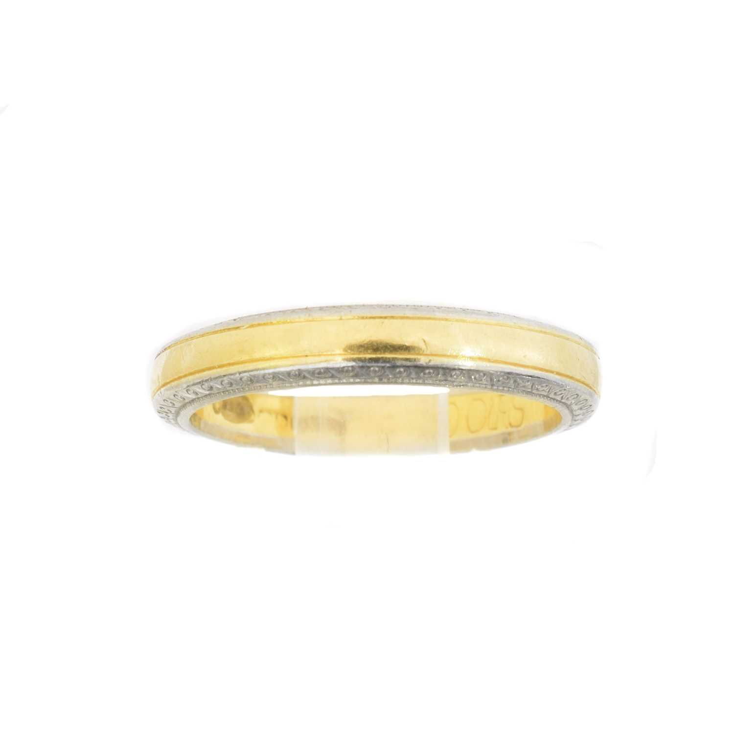 An 18ct gold band ring by Boodles,