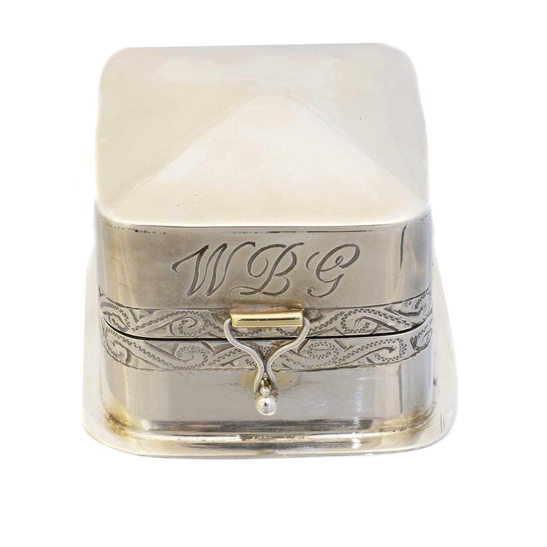 A silver ring box,
