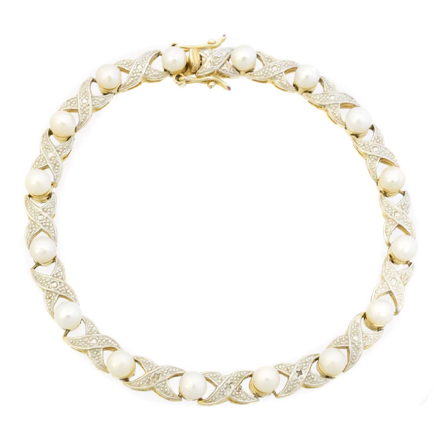 A cultured pearl and diamond bracelet,