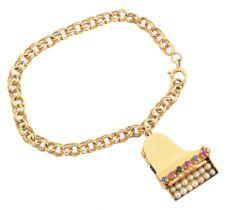 A mid 20th century charm bracelet,