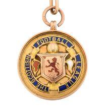 An early 20th century 9ct gold enamel football medallion,