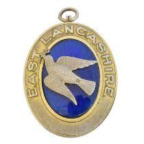 A silver gilt and enamel masonic locket,