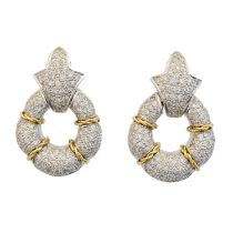 A pair of 18ct gold diamond earrings,