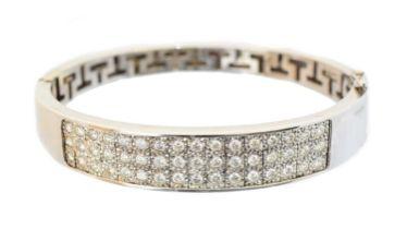 An 18ct gold diamond hinged bangle,