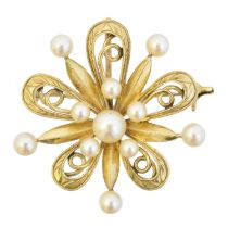 A cultured pearl brooch by Mikimoto