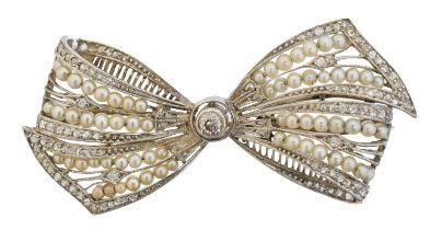 An early 20th century diamond and pearl brooch,
