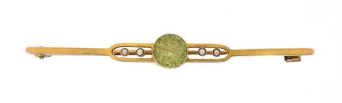 An early 20th century peridot and seed pearl brooch,