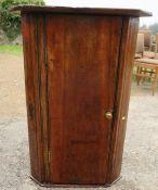 A primitive country corner cupboard, diameter 20ins