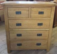 A modern oak chest, of two short over three long drawers, 39ins x 16.5ins x height 43ins