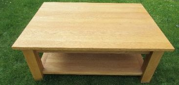 A modern pine two tier coffee table, 48ins x 36ins x height 19ins