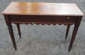 A 19th century mahogany side table, fitted with an end drawer, having a shaped frieze and raised