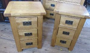 A pair of modern oak bedside cabinets, fitted with three drawers, 16ins x 18is x height 27.5ins