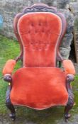 A Victorian mahogany show wood grandfather's chair, raised on short cabriole legs