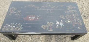 A 20th century oriental style black lacquer coffee table, of rectangular form, decorated with