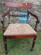 A 19th century mahogany Regency style open arm dining chair