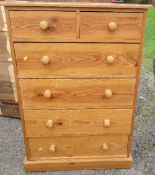 A pine chest, of two shortdrawers over four long drawers, raised on a plinth base, height 45.5ins x