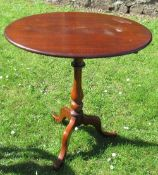 A 19th century mahogany oval tripod table, diameter 25.5ins x height 28ins