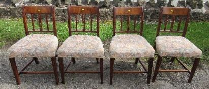 A set of four 19th century mahogany dining chairs, with stuff over seats