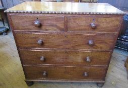 A 19th century mahogany chest, of two short over three long drawers, with moulded decoration to