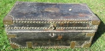 A leather covered trunk having brass corners, studs and handles, the plaque engraved, Lieutenant