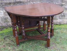 A Georgian style gate leg dining table, 66ins x 42ins