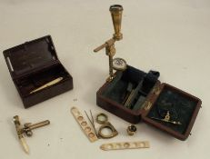 A Cary London lacquered brass portable pocket compound microscope, with slides, tweezers, lens