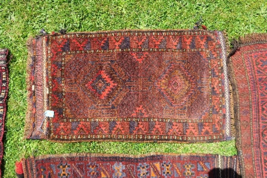 Four Eastern mats, all decorated with different designs to a red ground, all approximately 20ins x - Image 5 of 6