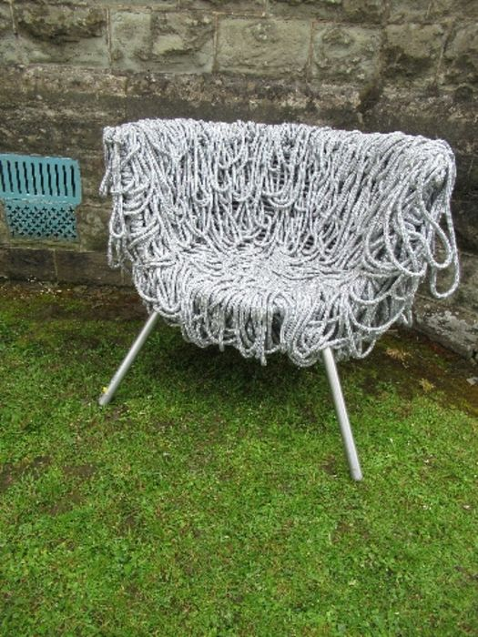 A draped silver rope designer armchair