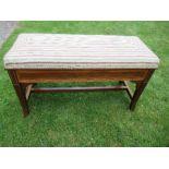 An Edwardian mahogany duet piano stool, with satinwood cross banding, and having a rising