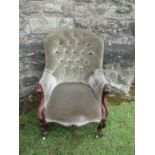 A Victorian chair, in green upholstery