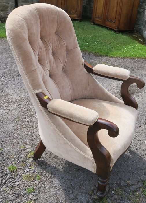 A William IV rosewood upholstered library chair, having turned fluted legs to the front, and sabre