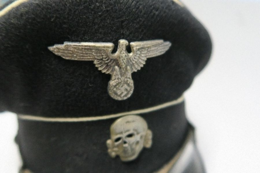 A WW2 style German SS visor cap, in black with white piping, bearing metal SS eagle and skull badges - Image 2 of 6