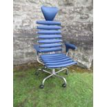 Blue leather skeleton chair by De Sede