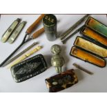 Two gold mounted cigar holders, together with propelling pencils, pen knife, curling tongs, papier-