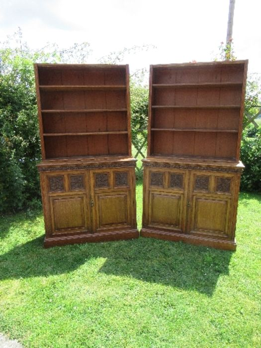 A pair of late 19th century oak bookcases, fitted open shelves to the upper section, and a further
