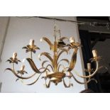 An eight branch gilt metal ceiling light, with foliate decoration, diameter approx 34ins