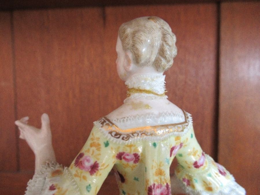 A pair of continental porcelain figures, of a man and a woman in period dress, the man holding a - Image 3 of 22