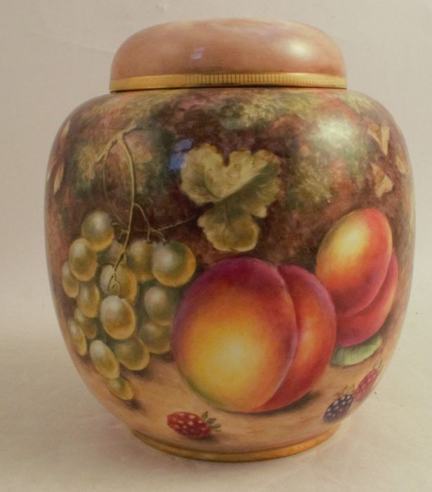 A Royal Worcester covered ginger jar, decorated all over with hand painted fruit by Freeman,