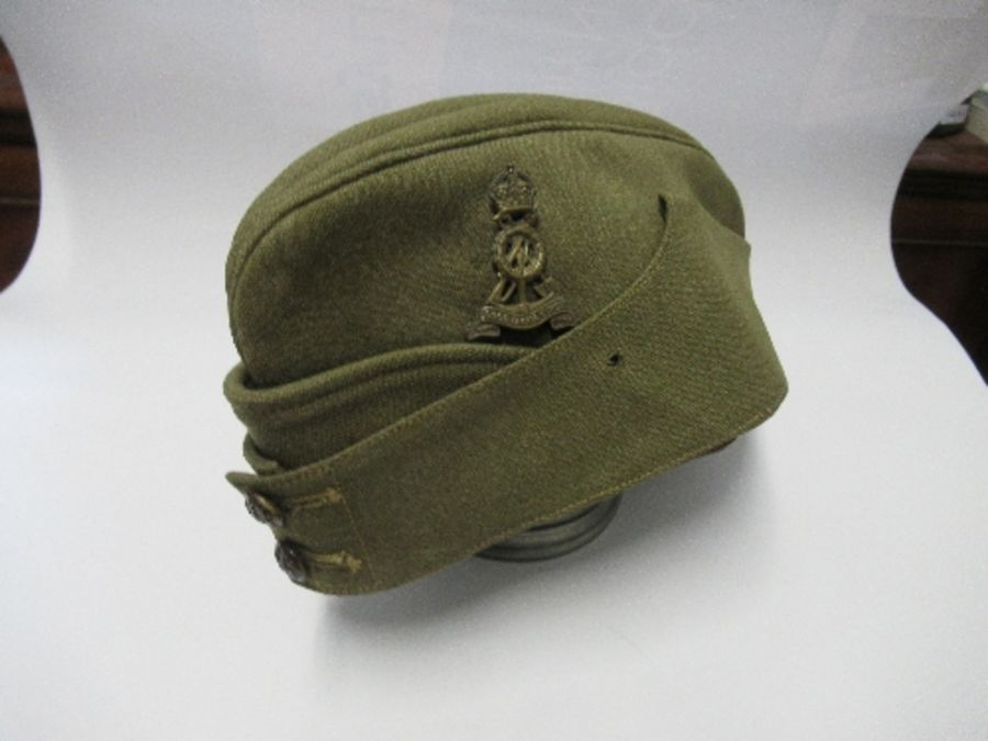 A British naval style visor cap in white cotton, with anchor and crown to the front on a black hat - Image 10 of 13