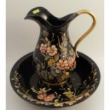 A Bassona wash jug and bowl, decorated with flowers to a black ground, signed
