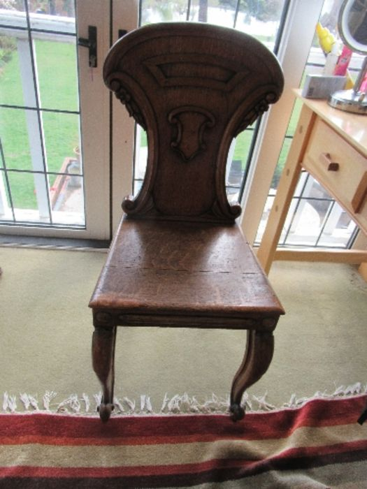 Two pairs of armorial hall chairs, in oak - Image 6 of 6