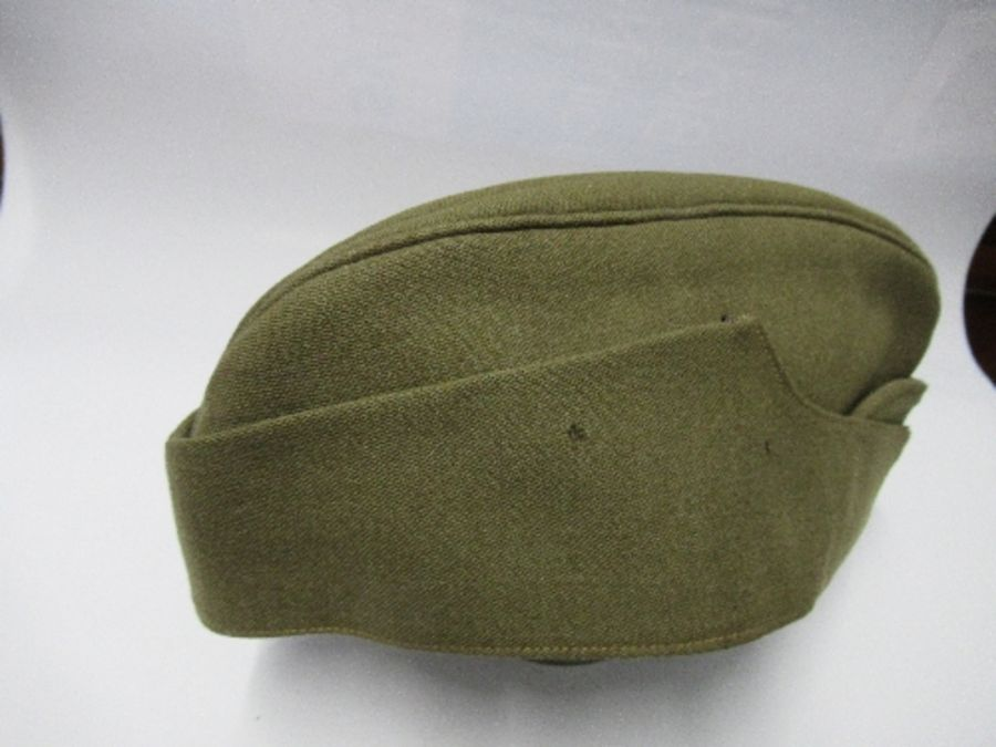 A British naval style visor cap in white cotton, with anchor and crown to the front on a black hat - Image 12 of 13